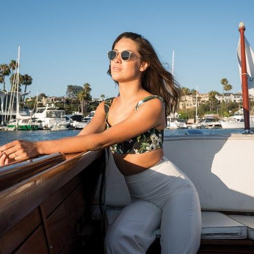 Woman on a boat wearing sunglasses